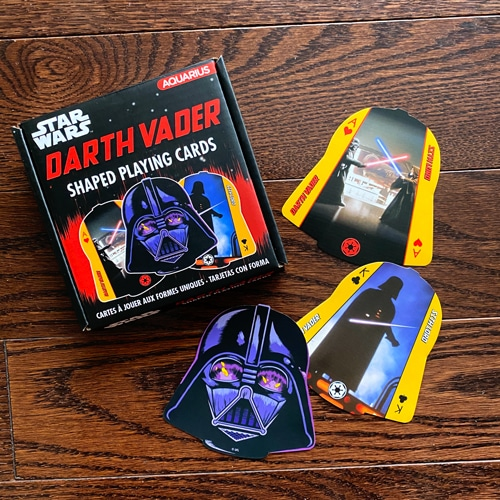 Sometimes, The Dark Side Can Be So Good.  Check out our New Darth Vader (Shaped) Playing Cards.